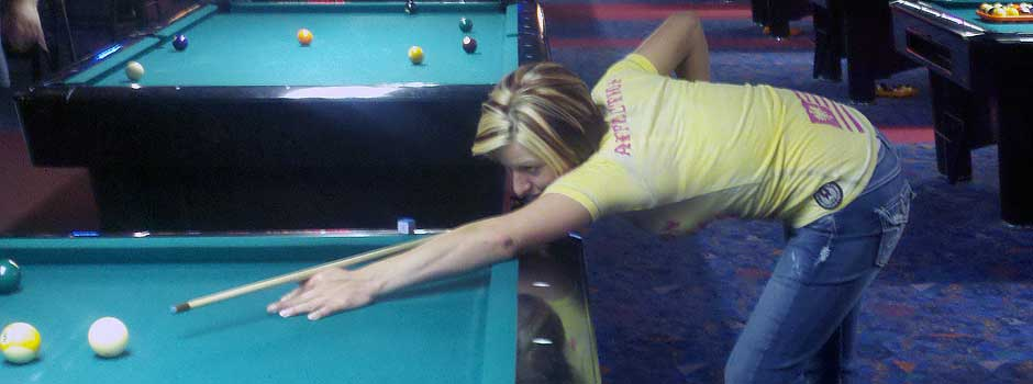 Girl Playing Pool at Cue's Billiards